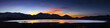 Desert lake, flooded playa at Sunset with mountain ranges and colorful clouds.  White Lake,  Cold Springs, Nevada