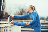 Woman exercising on bridge