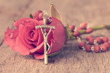 Silver crucifix and single rose