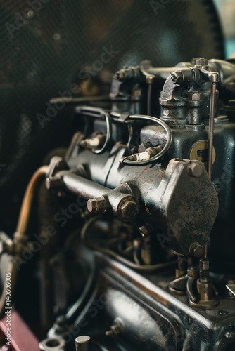 Close-up of engine of old fire truck.
