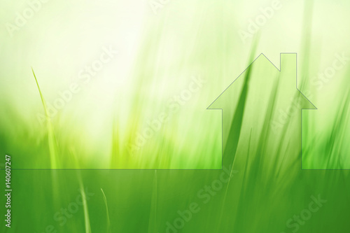 Eco green house concept copy space background with blurred meadow texture. Friendly living in healthy modern home.