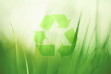 Lovely sunny blurred meadow with recycle symbol. Conceptual green clean environment background. - 140607615
