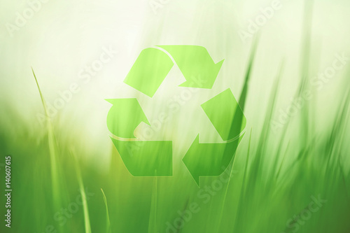 Lovely sunny blurred meadow with recycle symbol Poster