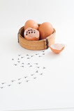 Count Calendar inside broken chicken egg shell. New born chick run away. Footprints on floor  - 140622271