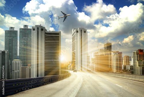 Foto op Plexiglas Motorsport city road through modern buildings or modern office building background