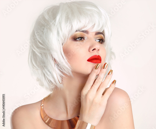 Blonde bob hairstyle. Blond hair. Fashion Beauty Girl portrait. Red lips. Manicured nails and Make-up. Jewelry set. Vogue Style Woman isolated on white background.