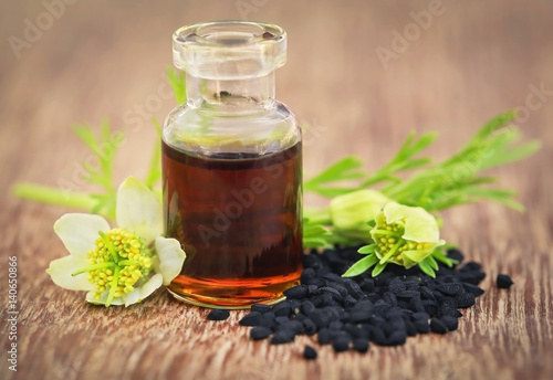 Nigella flower with seeds and essential oil - 140650866