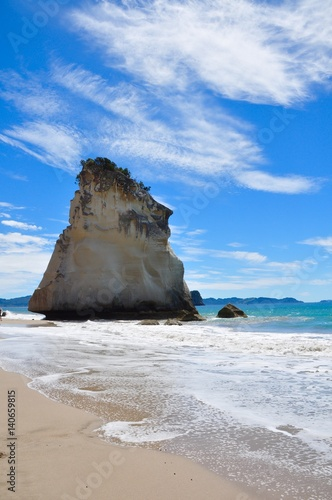 Foto Spatwand Cathedral Cove rock on the beach at cathedral cove