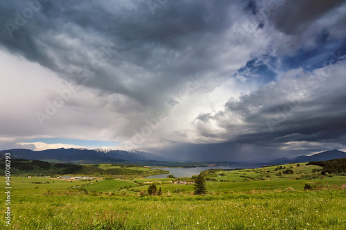 Aluminium Lente Spring rain and storm in mountains. Green spring hills of Slovakia