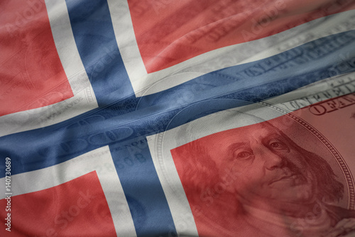 Poster colorful waving national flag of norway on a american dollar money background