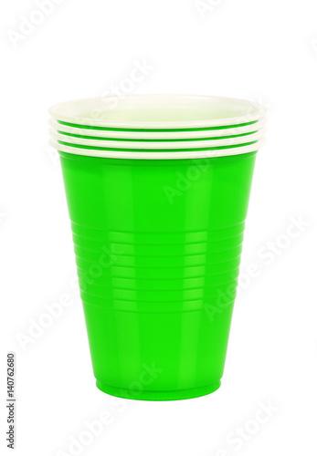 Leinwandbild Motiv Green plastic cups isolated on white background