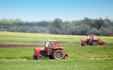 Tractors cutting lucerne