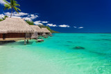 Best overwater bungalows on a tropical island with vibrant beach - 140777024