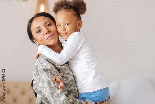 Lively child and her mother enjoying their reunion