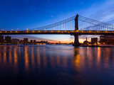 Bridge silhouetted against dawn sky