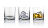 Fototapety Empty glass, glass with ice cubes and glass with whiskey and ice cubes. Isolated on white background