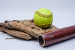 Ball on top of glove with wood bat