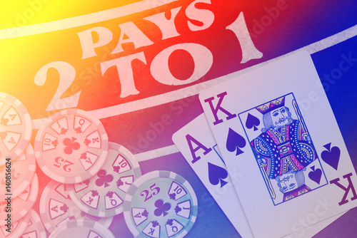 Blackjack playing cards hand on colorful background with chips stack Poster