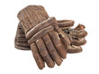 A pair of worn leather hockey gloves isolated on a white background.