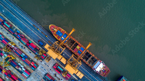 Foto Murales Container ship in import export and business logistic by crane