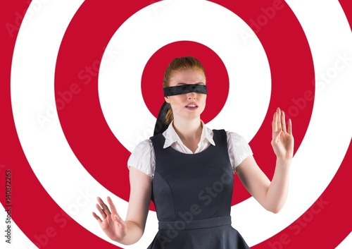 Blindfolded woman walking with her hands forward