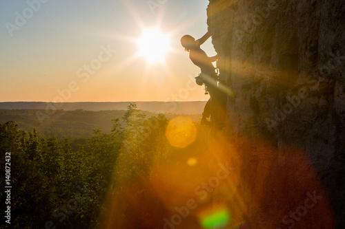 Silhouette of a Woman rock climbing on Ontario's Niagara Escarpment in Canada
