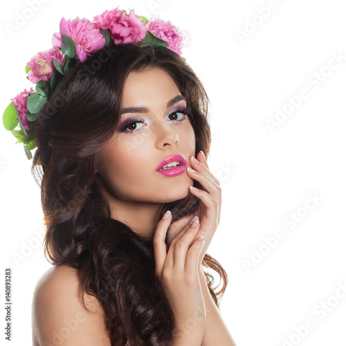 Fashion Model with Prom Hairstyle and Spring Flowers Wreath Isolated on White. Young Woman
