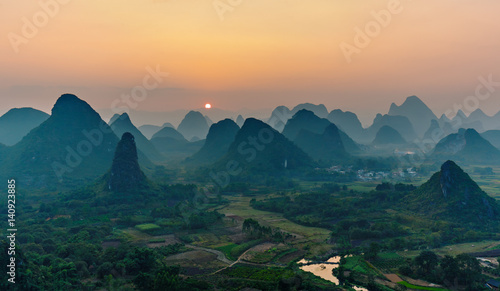 Foggy sunset. The view from the top of the Vine Mountains near Guilin - China © vadim_petrakov