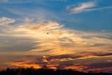 Wisps of clouds in the sky during a colorful sunset background