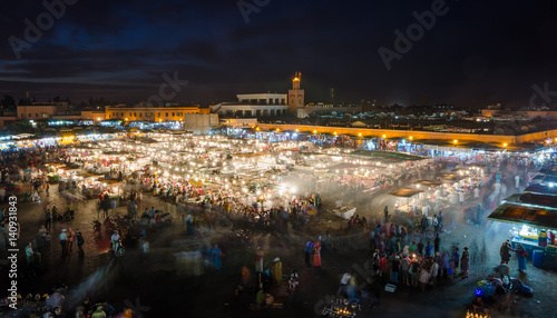 Fotobehang Marokko Famous square Jemaa El Fna busy with many people and lights during the night, medina of Marrakesh, Morocco