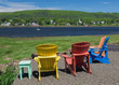 Adirondack chairs overlooking the Annapolis River in Nova Scotia, Canada.