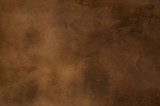 Fototapety Texture of a orange brown concrete as a background, brown grungy wall - Great textures for background