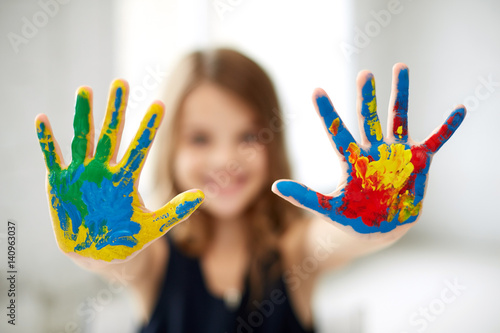 girl showing colored hands