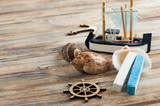 Seashells, wooden anchor and toy boat - 140965265