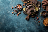 Dark chocolate pieces crushed and cocoa beans, culinary background, top view - 140972430