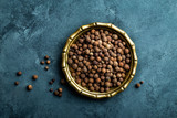 Allspice pepper, peppercorns on dark culinary background, top view, copy space - 140973211