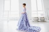 Beautiful girl in evening lilac dress