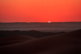 Beautiful sunset over the sand dunes in the Sahara desert, Morocco