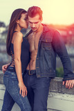 Sexy young couple posing in sunset outdoors