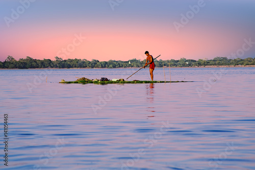 Poster INLE LAKE, MYANMAR - NOVEMBER 15, 2015: Local worker collecting weed from the fr