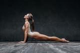 Young beautiful fitness female posing in studio - 141056261