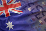 colorful waving national flag of australia on a euro money banknotes background. finance concept