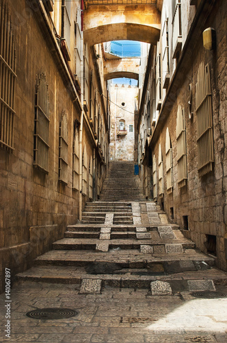 Fototapeta Old city street, stairs, stone stairway and arch. Jerusalem, Israel