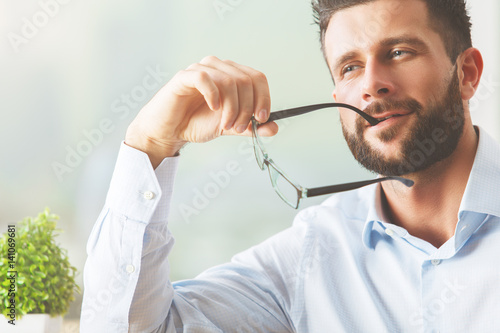 Thinking man with glasses