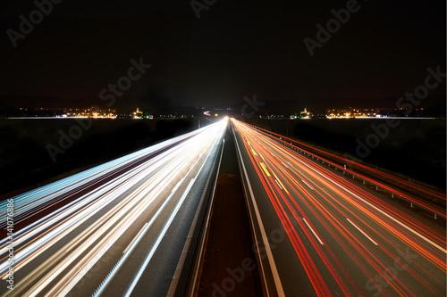 Foto op Aluminium Nacht snelweg light trails on highway symmetrical