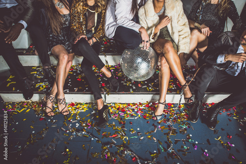 Party people celebrating in the club - 141125834