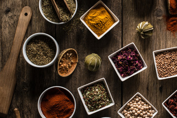 Various of colorful spices on wooden table. place for typography