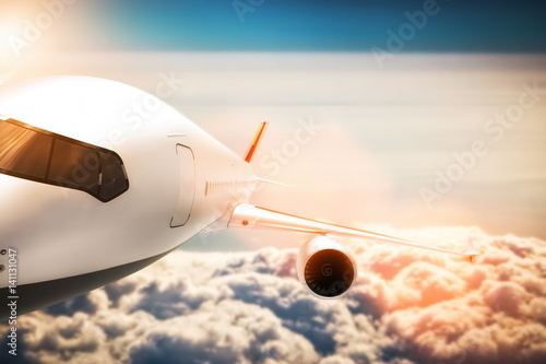 Passenger airplane flying at sunshine, blue sky. Poster