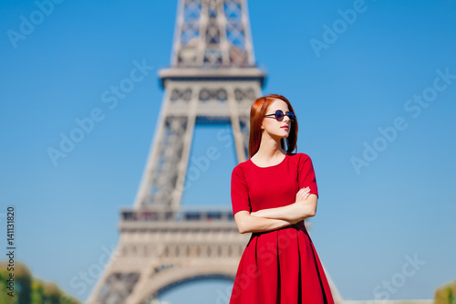 beautiful young woman on the Eiffel Tower background Photo by Masson