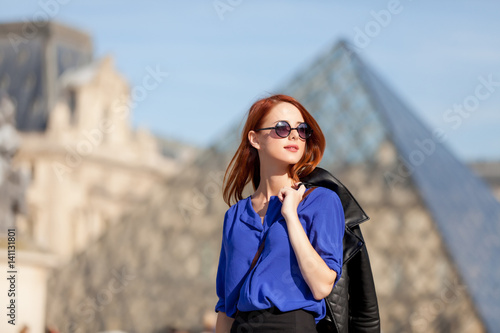 beautiful young woman walking near the Louvre Poster